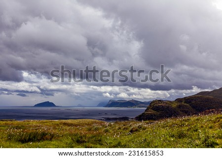 View from the bird cliffs on the ocean and clouds in Norway