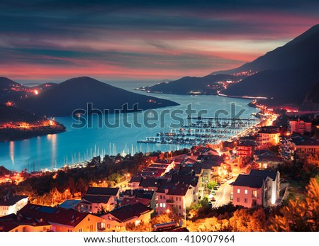 View from the bird's eye of the Kas city, district of Antalya Province of Turkey, Asia. Colorful spring sunset in small Mediterranean yachting and tourist town.