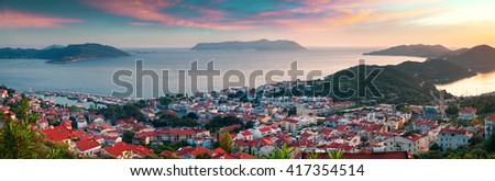 View from the bird's eye of the Kas city, district of Antalya Province of Turkey, Asia. Colorful spring panorama of small Mediterranean yachting and tourist town.  - stock photo