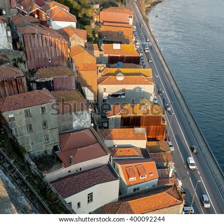 View from the bridge on the tiled roof of the Old city - Porto, Portugal - stock photo