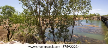 View from the bridge over Cockatoo Creek on  Great Northern Highway near Willare Crossing between Broome and Derby  North Western Australia on a cloudy very hot morning in  tropical summer Wet Season. - stock photo