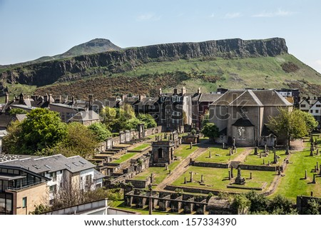 View from the Calton Hill to the Canongate Kirk and Salisbury Crags, Edinburgh City, Scotland - stock photo