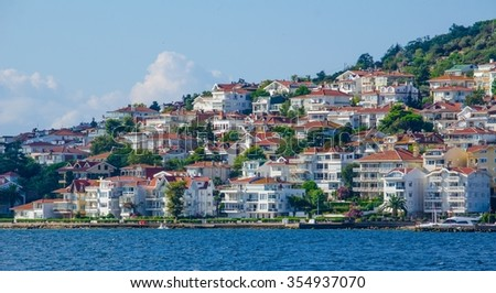View from the ferry, which runs along the route Istanbul - Buyukada. Architecture and tourists on the island Kinaliada