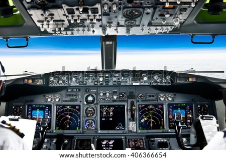 View from the flight deck of a modern jet airliner plane - stock photo