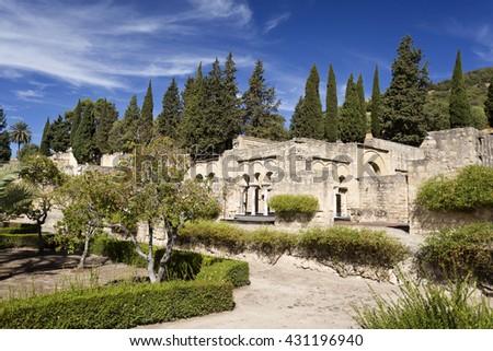 View from the gardens to the Upper Basilica Hall at Medina Azahara medieval palace-city near Cordoba, Spain - stock photo