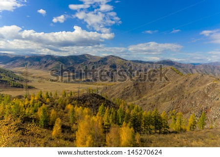 view from the height of the pass at the autumn landscape