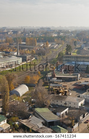 view from the height over industrial district with railroad - stock photo