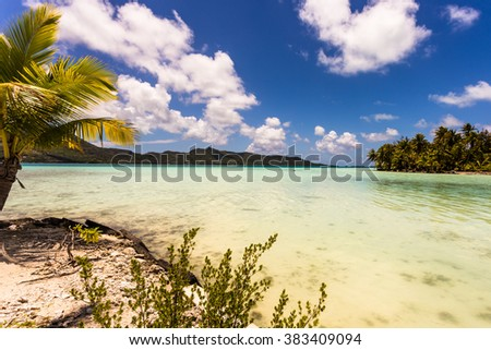 View from the island Motu Bora Bora island across the lagoon with turquoise water - stock photo