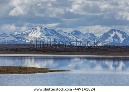 View from the Kjölur road toward the mountains of Kerlingarfjoll reflection in the a lake near the road. - stock photo