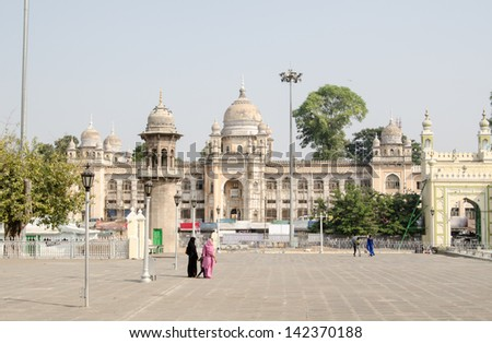 View from the Mecca Masjid mosque in the Charminar district of Hyderabad looking towards the Nizamia General Hospital. - stock photo