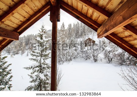 View from the mountain chalet window / Haute Savoie, France - view from the wooden ski chalet window - stock photo