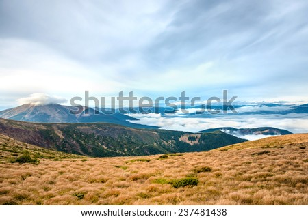 View from the mountain to beautiful landscape with grass and blue clouds. Hoverla, Ukraine. - stock photo