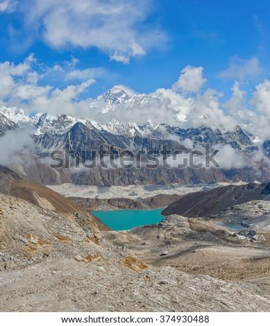 View from the Renjo Pass (5360 m) on the Mahalangur Himal, Ngozumba glacier, Dudh Pokhari Lake, and the Gokyo village - Nepal, Himalayas - stock photo