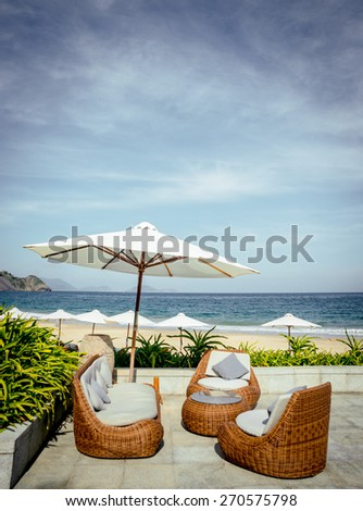 View from the restaurant on the beach. Furniture - stock photo