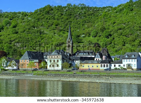 View from the River Rhine of a village in the famous Rhine Gorge region north of Rudesheim, Germany - stock photo