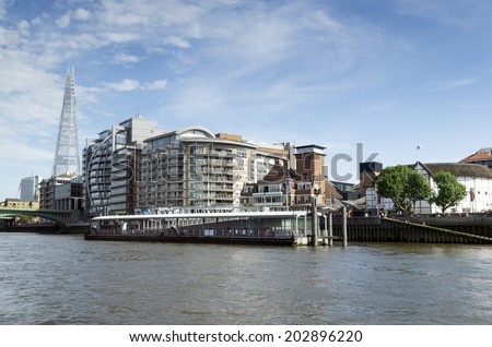 View from the River Thames. Late afternoon sun lights up the London skyline. The Shard is the tallest skyscraper in Western Europe.  - stock photo