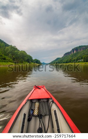 View from the rubber boat on the summer river in the deep canyon