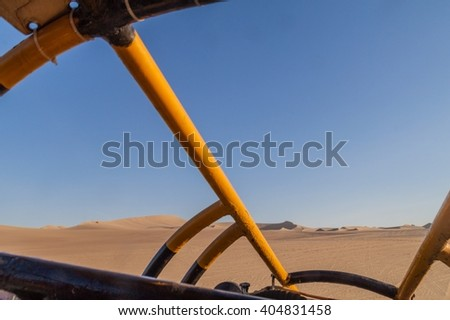 View from the sand dune buggy in the dunes of Huacachina desert, Peru - stock photo
