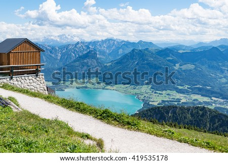 view from the Schafberg mountaintop on a sunny day, Austrian Alps, lake Wolfgangsee, St. Wolfgang, Austria - stock photo