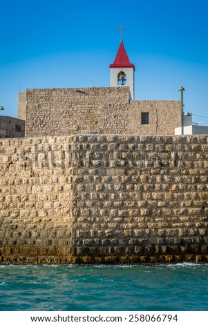 View from the see on walls of Acre, Israel - stock photo