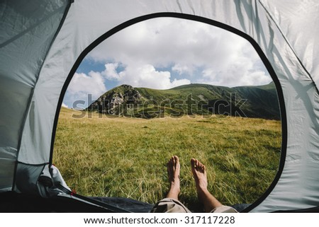 view from the tent. Hiking and Tourism - stock photo