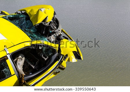 View from the top front of the yellow car, which was demolished in the accident, floating on the water.