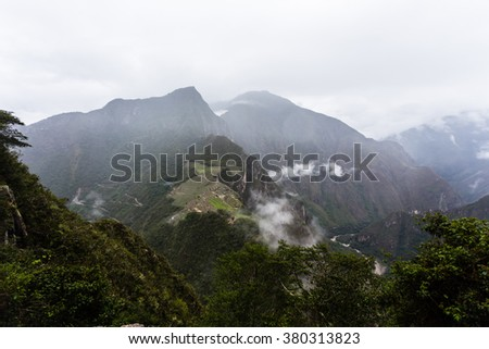 View from the top of Huayna Picchu, the lost city of the Incas at Machu Picchu, Peru in rainy weather