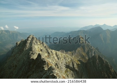 View from the top of Rysy (2499 m) on a smaller peak in the Tatra Mountains, Poland. - stock photo