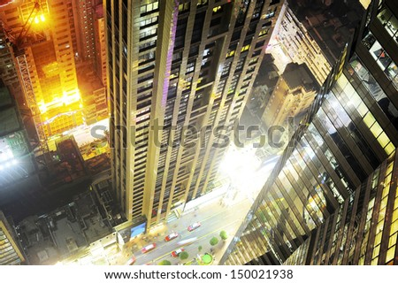 View from the top of skyscraper to Hong Kong city center street at night - stock photo