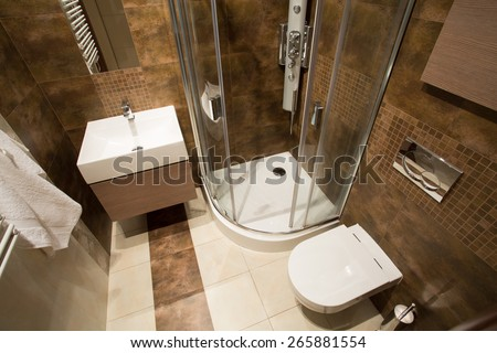 View from the top of small bathroom with brown tiles - stock photo