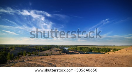 View from the top of the hill on lake landscape with beautiful reflection of a sky - stock photo