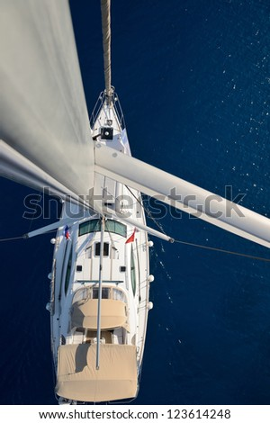 view from the top of the mast sailing yacht - stock photo