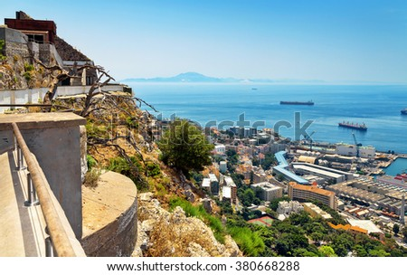 View from the top of the rock of Gibraltar on the city. Africa is visible on the horizon. - stock photo
