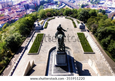 View from the top of the Vitkov Memorial on the Prague landscape and the memorial on a sunny day - stock photo