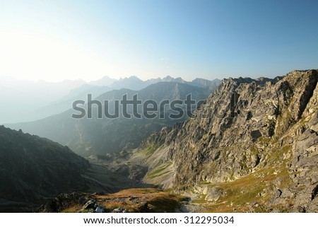 View from the top to the High Tatras at dawn. - stock photo