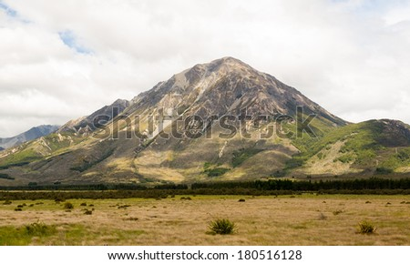 View from the train windows of TranzAlpine railway that climbs the Southern Alps in New Zealand towards Arthurs Pass - stock photo