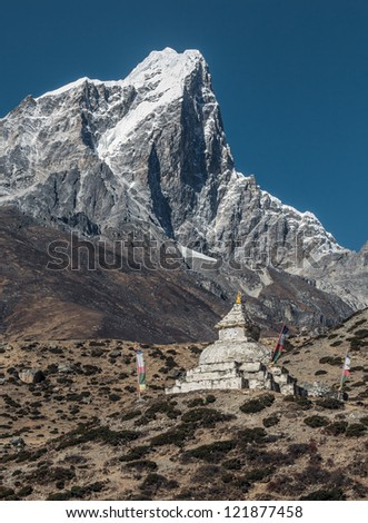 View from the village of Dingboche at ancient Buddhist stupa on the background of peak Tabuche - Everest region, Nepal, Himalayas - stock photo