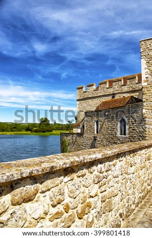 View from the walls of Leeds Castle which is in the island on the lake in Kent in England. The castle was built in the twelfth century as a king residence. Now it is open to the public. - stock photo