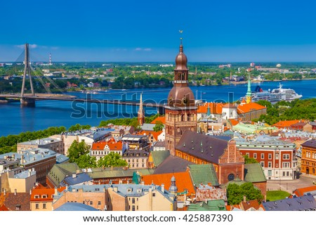 View from tower of Saint Peters Church on Riga Cathedral and roofs of old houses in old city of Riga, Latvia. - stock photo