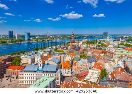 View from tower of St. Peters Church on Riga Cathedral and roofs of old houses in old city of Riga, Latvia. - stock photo