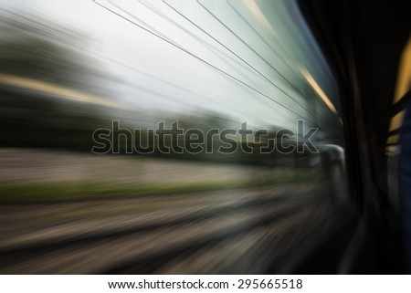 view from train window, traveling speed background - stock photo
