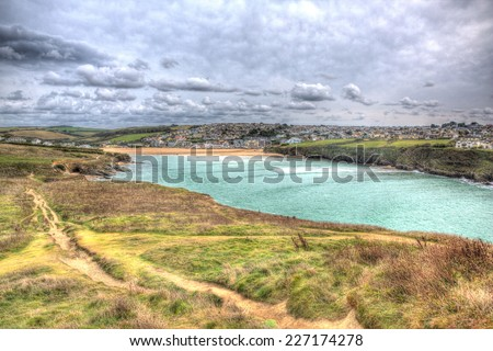 View from Trevelgue Head towards Porth beach Newquay Cornwall England UK in HDR with coast path - stock photo