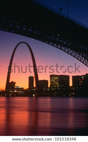View from under the Eads Bridge of St. Louis Missouri skyline and archway at night - stock photo