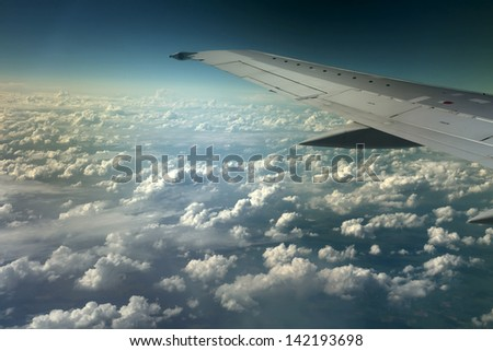 View from window of a jet plane wing with beautiful weather - stock photo