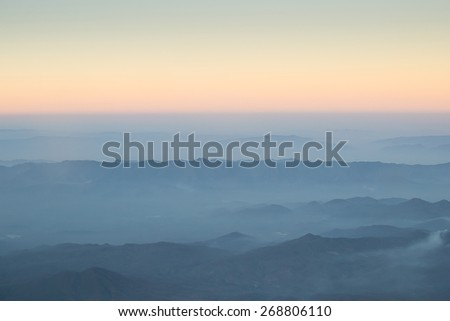 view from window of an airplane flying over Chiangmai Thailand. - stock photo
