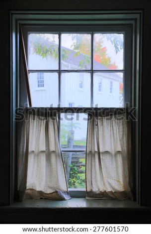 View from window of the old wooden log house - stock photo