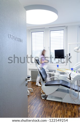 view in a room of Dentistry with Assistent on the background. - stock photo