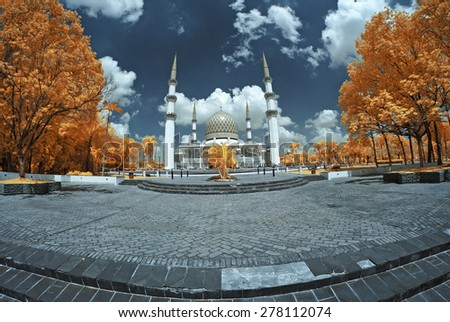 View in Infrared of Sultan Salahuddin Abdul Aziz Shah Mosque. Image has grain or blurry or noise and soft focus when view at full resolution.  (Shallow DOF, slight motion blur) - stock photo