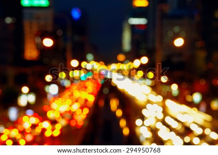 View in night time to the city road with blured motion cars lights from overpass - stock photo