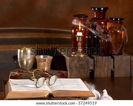 View in the kitchen of a wizard or witch, with recipe books and poison bottles